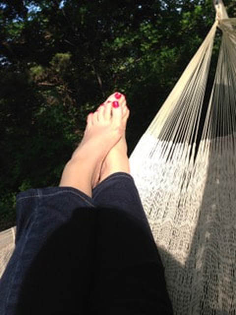 Bare feet in a hammock